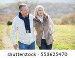senior couple walking in...   Shutterstock . vector #553625470