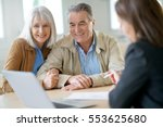 Small photo of Senior couple meeting financial adviser for investment