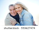 portrait of senior couple... | Shutterstock . vector #553627474