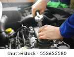 mechanic repairing car with... | Shutterstock . vector #553632580