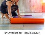 woman rolling her mat before a...   Shutterstock . vector #553638334