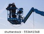 the cameraman filming an... | Shutterstock . vector #553641568