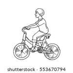 boy rides a bicycle ride ...