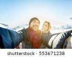 young couple making selfie snow ... | Shutterstock . vector #553671238