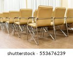 Rows Of Metal Chairs At The...