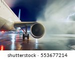 airport in winter. deicing of... | Shutterstock . vector #553677214