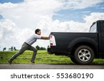 Man Pushing A Broken Car Down...