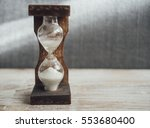 old hourglass on the table | Shutterstock . vector #553680400