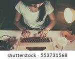 Young Woman Using Typewriter...