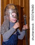 Small photo of Kolomna, Russia - January 03, 2017: little boy was allowed to try Blacksmith Settlement museum exhibits by Andrey Kopylov, aka linkpusher