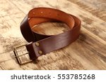 stylish leather belt on wooden... | Shutterstock . vector #553785268