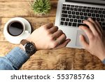 hands of young man looking at... | Shutterstock . vector #553785763