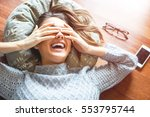 beautiful young woman laying on ... | Shutterstock . vector #553795744