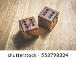 two wooden dice with the number ... | Shutterstock . vector #553798324