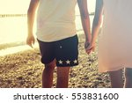 two hands holding each other... | Shutterstock . vector #553831600