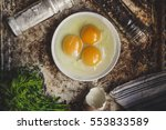 Three Broken Eggs In A Plate