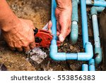 the man is cutting the... | Shutterstock . vector #553856383
