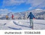 mountain ski slope on a sunny... | Shutterstock . vector #553863688