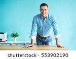 happy business man leaning on a ... | Shutterstock . vector #553902190