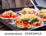 mini focaccia with tomatoes ... | Shutterstock . vector #553934914