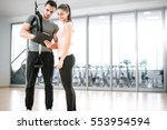personal trainer showing result ... | Shutterstock . vector #553954594