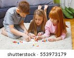 siblings playing a game at home.... | Shutterstock . vector #553973179