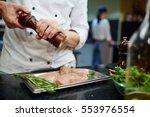 cooking chiken steaks | Shutterstock . vector #553976554