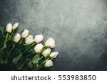 Stock photo white roses on gray empty copy space surface 553983850