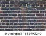 Small photo of Dark bricks, blacken weathered wall texture background
