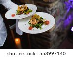 waiter carrying a plate with...   Shutterstock . vector #553997140