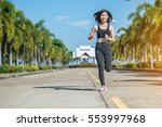 beautiful woman jogging on the... | Shutterstock . vector #553997968