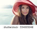 beautiful girl in a red hat... | Shutterstock . vector #554005048