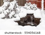 Snow Covered Outdoor Water...