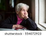 an elderly woman sadly looking...   Shutterstock . vector #554072923