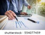 teamwork process  businessmen... | Shutterstock . vector #554077459