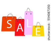 sale poster with shopping bags... | Shutterstock .eps vector #554087350