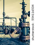 Small photo of Group of wellhead. Oilfield with sand ground. Oil and gas . Toned.