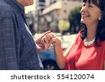mature people romantic holding... | Shutterstock . vector #554120074