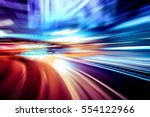 moving traffic light trails at... | Shutterstock . vector #554122966