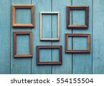 old wooden frames on old blue... | Shutterstock . vector #554155504