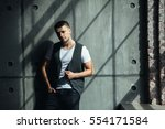 young man in a vest | Shutterstock . vector #554171584