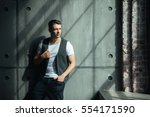 young man in a vest | Shutterstock . vector #554171590