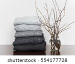 pile of grey knitted sweaters... | Shutterstock . vector #554177728