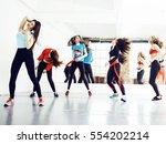 women doing sport in gym ... | Shutterstock . vector #554202214