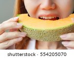 asian women eating a slice of a ...   Shutterstock . vector #554205070