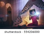 child in an astronaut costume... | Shutterstock . vector #554206000