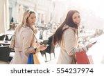 two beautiful smiling women... | Shutterstock . vector #554237974