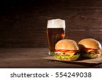 hamburger and dark beer in... | Shutterstock . vector #554249038