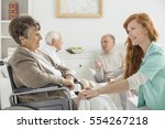 nurse taking care of senior... | Shutterstock . vector #554267218