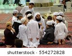 Small photo of Mecca, Saudi Arabia 30 Nov. 2016 : Muslim children learning Quran or Koran in Prophet's Mosque (Al-Nabawi). The mosque is one of the three holiest mosque in Islam.